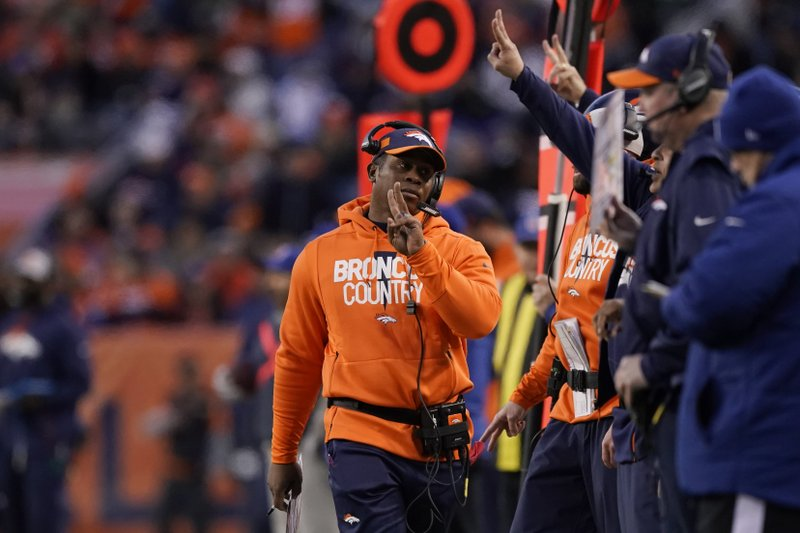 Denver Broncos head coach Vance Joseph, center, reacts on the sideline during the second half of an NFL football game against the Los Angeles Chargers, Sunday, Dec. (AP Photo/Jack Dempsey)