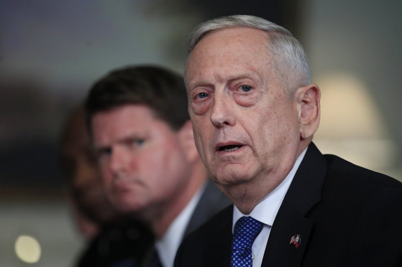 FILE - In this Sept. 18, 2018, file photo, Defense Secretary Jim Mattis responds to a reporter's question during a meeting with and Philippine Secretary of National Defense Delfin Lorenzana at the Pentagon. (AP Photo/Manuel Balce Ceneta, File)