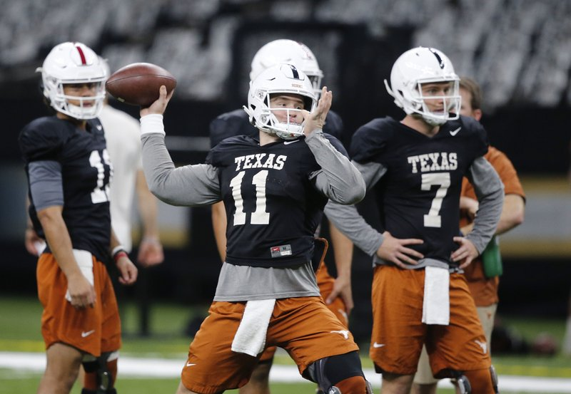 Texas quarterback Sam Ehlinger (11) throws during practice at the Superdome in New Orleans, Friday, Dec. (AP Photo/Gerald Herbert)