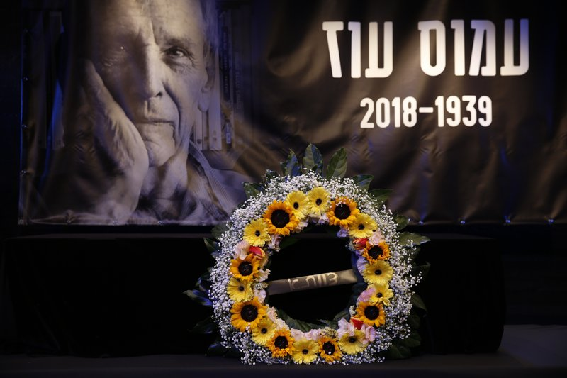 The coffin of Amos Oz is placed on a theater stage during his funeral service in Tel Aviv, Israel, Monday, Dec. (AP Photo/Ariel Schalit)