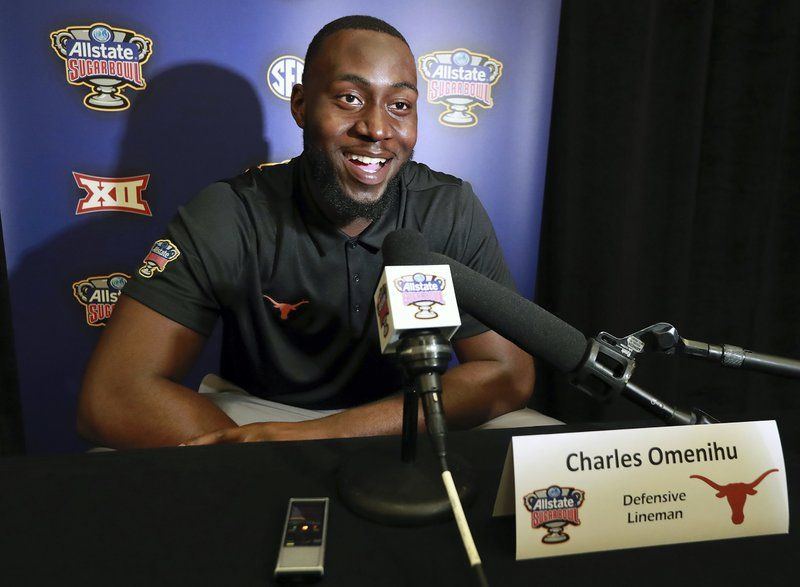 Texas defensive lineman Charles Omenihu takes questions during a news conference, Sunday, Dec. 30, 2018 in New Orleans. (Curtis Compton/Atlanta Journal-Constitution via AP)