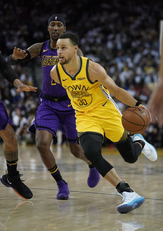 Golden State Warriors guard Stephen Curry (30) drives to the basket against Los Angeles Lakers guard Kentavious Caldwell-Pope (1) during the second half of an NBA basketball game Tuesday, Dec. (AP Photo/Tony Avelar)