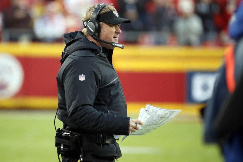 Oakland Raiders head coach Jon Gruden watches the first half of an NFL football game against the Kansas City Chiefs in Kansas City, Mo. (AP Photo/Charlie Riedel)