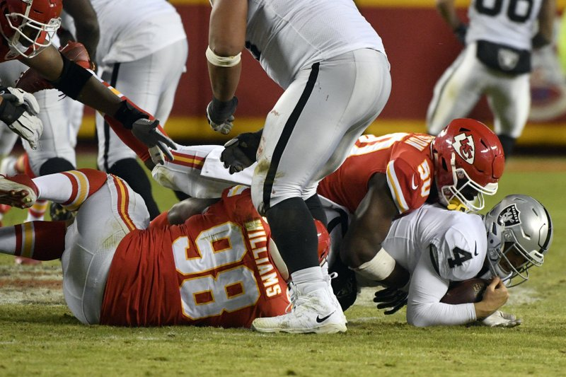 Kansas City Chiefs linebacker Justin Houston (50) sacks Oakland Raiders quarterback Derek Carr (4) during the second half of an NFL football game in Kansas City, Mo. (AP Photo/Ed Zurga)