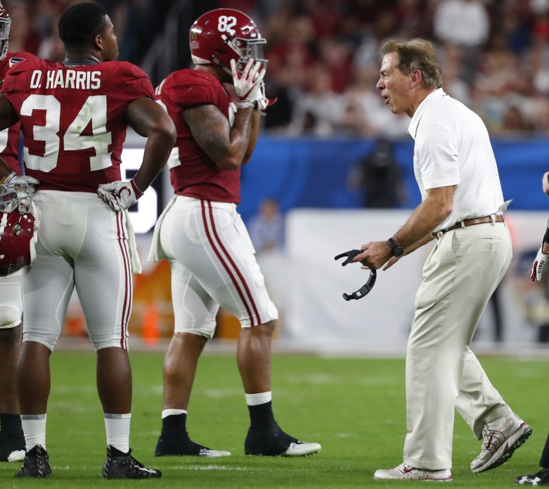 Alabama head coach Nick Saban, screams at tight end Irv Smith Jr. (82) and running back Damien Harris (34), during the first half of the Orange Bowl NCAA college football game against Oklahoma, Saturday, Dec. (AP Photo/Wilfredo Lee)