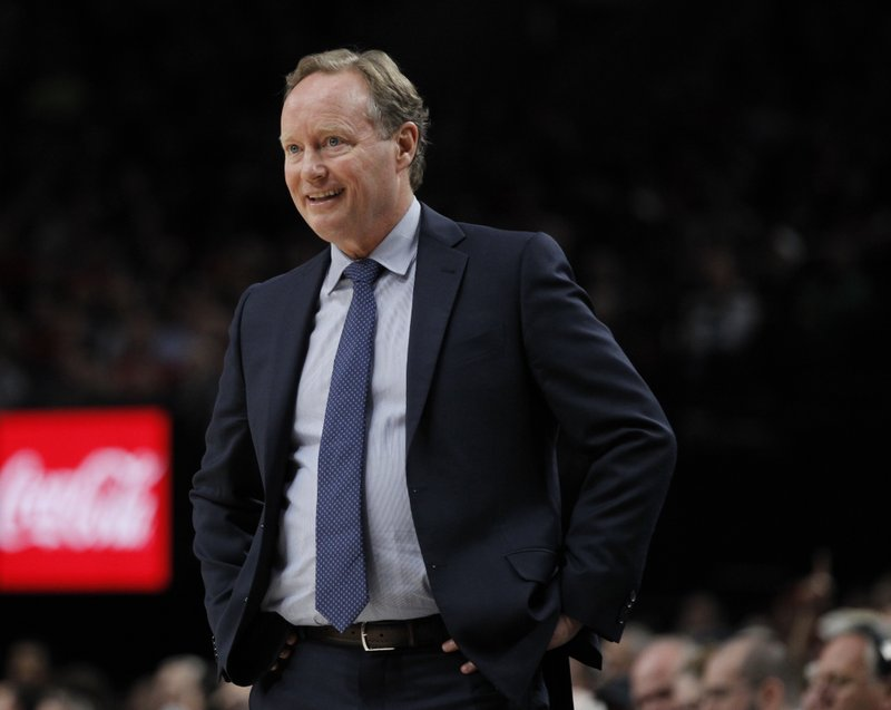 FILE- In this Nov. 6, 2018, file photo Milwaukee Bucks coach Mike Budenholzer watches his team play against the Portland Trail Blazers during the first half of an NBA basketball game in Portland, Ore. (AP Photo/Steve Dipaola, File)