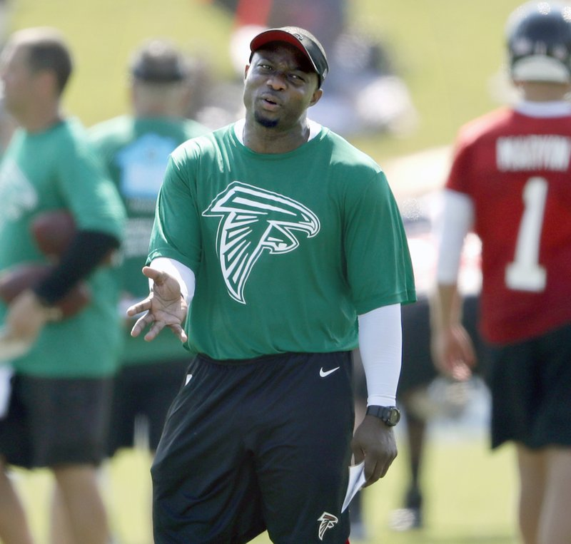 FILE - In this July 27, 2018, file photo, Atlanta Falcons defensive coordinator Marquand Manuel stands on the field at an NFL football training camp practice in Flowery Branch, Ga. (AP Photo/David Goldman, File)