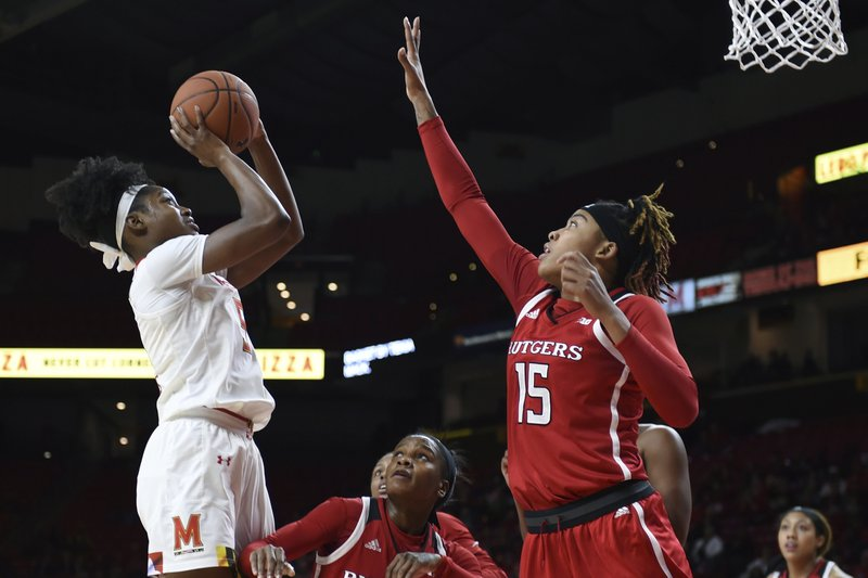 Maryland's Kaila Charles, left, shoots as Rutgers Ciana Cryor, center, and Caitlin Jenkins, right, defend in the first half of an NCAA college basketball game, Monday, Dec. (AP Photo/Gail Burton)
