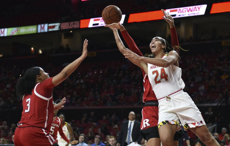 Maryland's Stephanie Jones, right, shoots as Rutgers Charice Wilson, left, defends in the first half of a NCAA college basketball game, Monday, Dec. (AP Photo/Gail Burton)