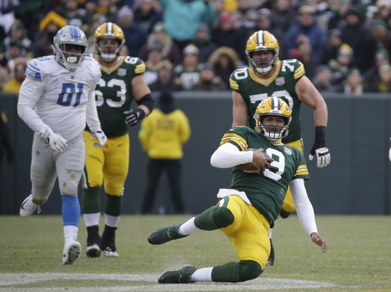 Green Bay Packers' DeShone Kizer slides after running for a first down during the second half of an NFL football game against the Detroit Lions Sunday, Dec. (AP Photo/Mike Roemer)