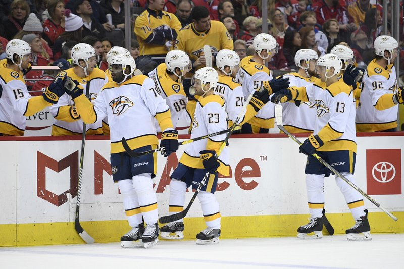 Nashville Predators center Rocco Grimaldi (23) celebrates his goal with the bench and defenseman P.K. (76) and center Nick Bonino (13) during the first period of an NHL hockey game against the Washington Capitals, Monday, Dec. 31, 2018, in Washington. (AP Photo/Nick Wass)