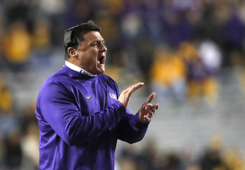 FILE- In this Nov. 17, 2018 file photo, LSU head coach Ed Orgeron calls out from the sideline in the second half of an NCAA college football game against Rice in Baton Rouge, La. (AP Photo/Gerald Herbert, File)