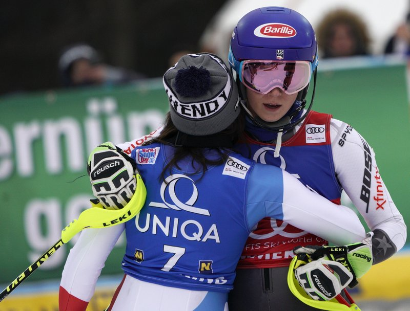 United States' Mikaela Shiffrin, right, celebrates with Switzerland's Wendy Holdener at the end of the second run of an Alpine ski, women's World Cup slalom in Semmering, Austria, Saturday, Dec. (AP Photo/Giovanni Auletta)
