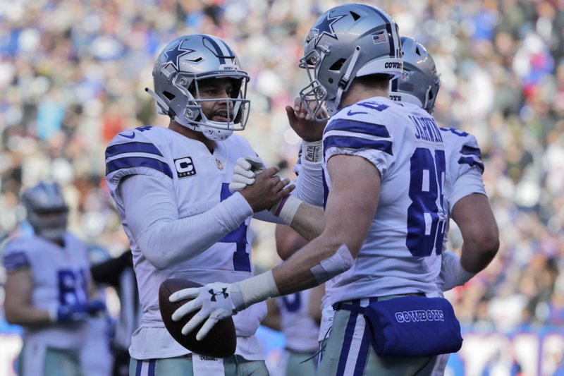 Dallas Cowboys quarterback Dak Prescott, left, and Blake Jarwin celebrate their touchdown during the first half of an NFL football game against the New York Giants, Sunday, Dec. (AP Photo/Frank Franklin II)