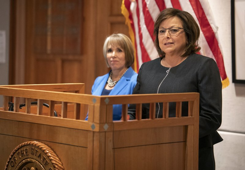 FILE - In this Nov. 9, 2018, file photo, New Mexico Gov. Susana Martinez, right, and U.S. Rep. Michelle Lujan Grisham, who was elected in November as the state's next governor, hold a joint press conference following a meeting at the State Capitol in Santa Fe, N. (AP Photo/Craig Fritz, File)