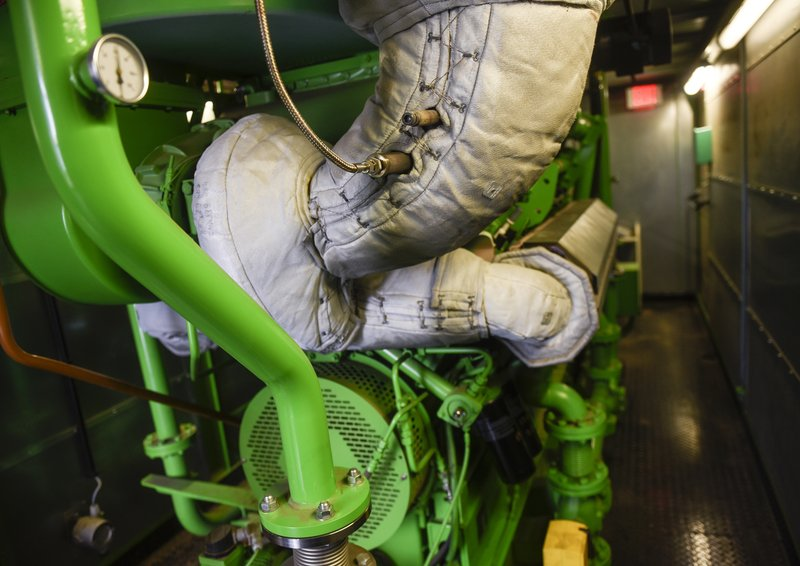 In this Tuesday, Dec. 11, 2018 photo, a large engine runs on biogas at the Wastewater Treatment Facility in St. (Nutrients, Energy and Water) Recovery Facility, where nutrients are recovered, waste is treated, and clean water is sent back into the environment. (Dave Schwarz/St. Cloud Times via AP)