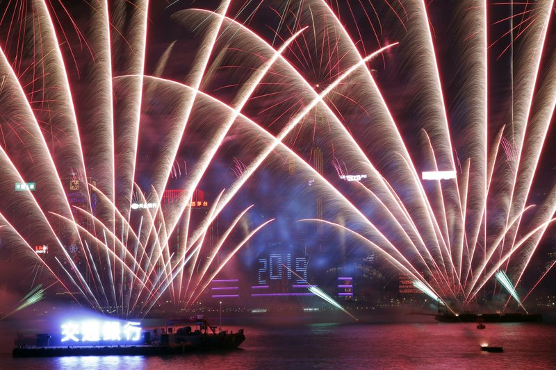 Fireworks explode over the Victoria Harbor during New Year's Eve to celebrate the start of year 2019 in Hong Kong, Tuesday, Jan. (AP Photo/Kin Cheung)