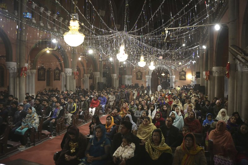 Pakistani Christians attend a midnight service at Sacred Heart Cathedral, ending of the year 2018 in Lahore, Pakistan, Monday, Dec. (AP Photo/K.M. Chaudary)