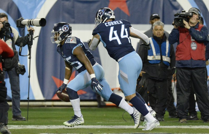 Tennessee Titans inside linebacker Jayon Brown (55) scores a touchdown on a 22-yard pass interception against the Indianapolis Colts in the first half of an NFL football game Sunday, Dec. (44). (AP Photo/Mark Zaleski)