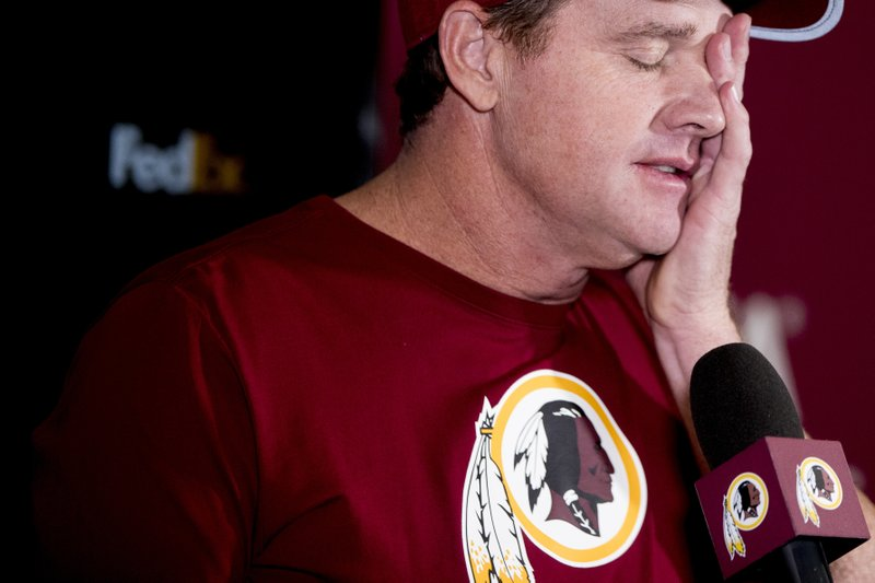 Washington Redskins head coach Jay Gruden pauses while speaking at a news conference at Redskins Park, Monday, Dec. (AP Photo/Andrew Harnik)