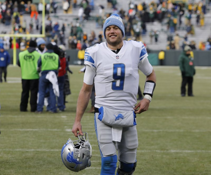 Detroit Lions' Matthew Stafford smiles as he walks off the field after an NFL football game against the Green Bay Packers Sunday, Dec. (AP Photo/Mike Roemer)