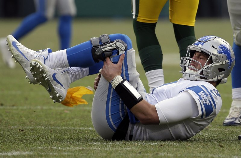 Detroit Lions quarterback Matthew Stafford reacts after being hit late by Green Bay Packers' Fadol Brown during the second half of an NFL football game Sunday, Dec. (AP Photo/Mike Roemer)