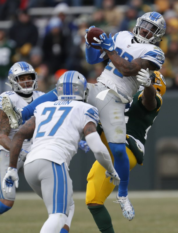 Detroit Lions' Quandre Diggs intercepts a pass during the second half of an NFL football game against the Green Bay Packers Sunday, Dec. (AP Photo/Matt Ludtke)