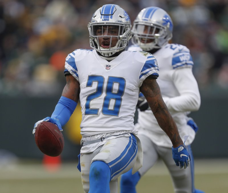 Detroit Lions' Quandre Diggs reacts after intercepting a pass during the second half of an NFL football game against the Green Bay Packers Sunday, Dec. (AP Photo/Matt Ludtke)
