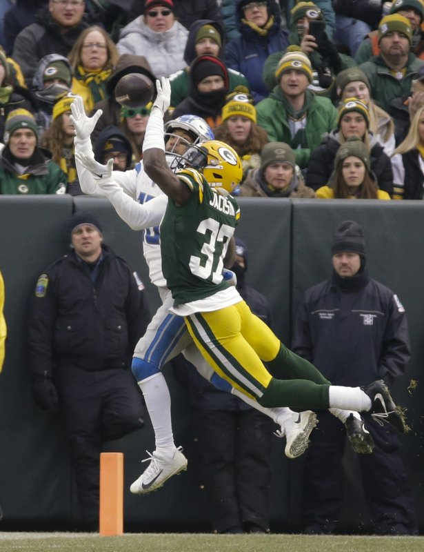 Detroit Lions' T.J. Jones catches a touchdown pass in front of Green Bay Packers' Josh Jackson during the second half of an NFL football game Sunday, Dec. (AP Photo/Mike Roemer)