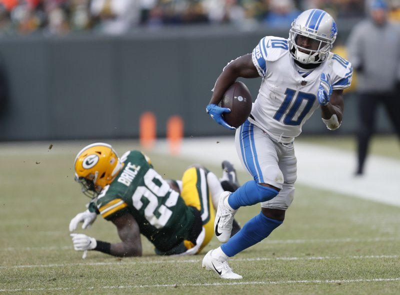 Detroit Lions' Brandon Powell gets away from Green Bay Packers' Kentrell Brice during the second half of an NFL football game Sunday, Dec. (AP Photo/Matt Ludtke)