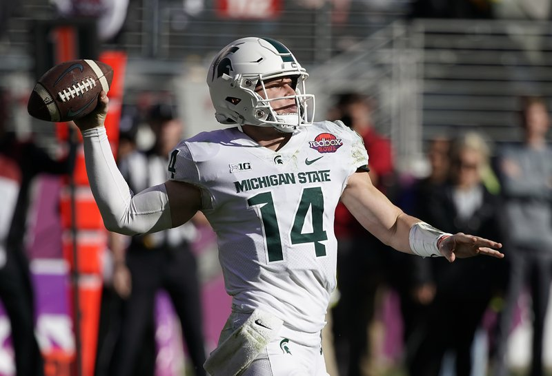 Michigan State quarterback Brian Lewerke (14) throws a pass against Oregon during the first half of the Redbox Bowl NCAA college football game Monday, Dec. (AP Photo/Tony Avelar)