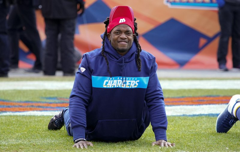 Los Angeles Chargers running back Melvin Gordon wears a University of Wisconsin hat as he warms up before an NFL football game against the Denver Broncos, Sunday, Dec. (AP Photo/Jack Dempsey)