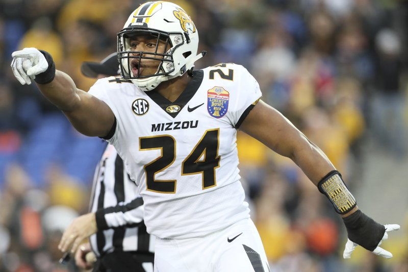 Missouri linebacker Terez Hall celebrates a tackle against Oklahoma State during the first half of the Liberty Bowl NCAA college football game in Memphis, Tenn. (Joe Rondone/The Commercial Appeal via AP)