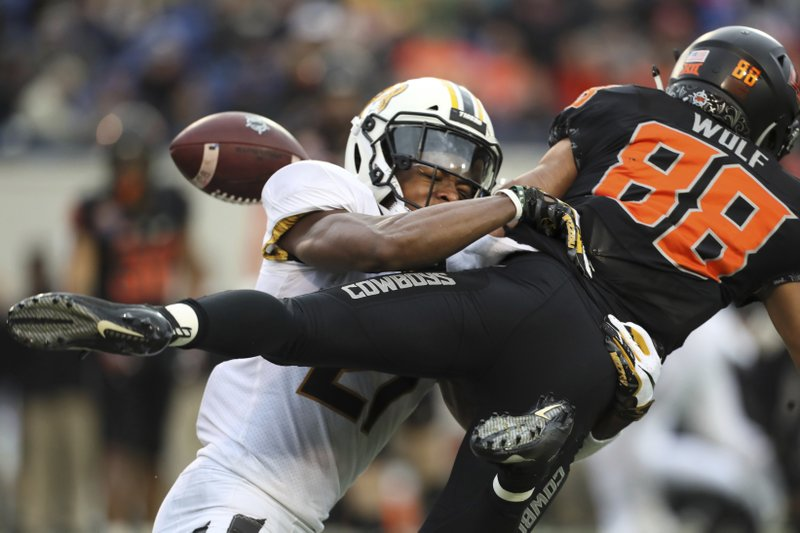 Missouri defensive back Christian Holmes breaks up a pass intended for Oklahoma State wide receiver Landon Wolf during the first half of the Liberty Bowl NCAA college football game in Memphis, Tenn. (Joe Rondone/The Commercial Appeal via AP)