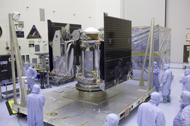 FILE - This May 21, 2016, file photo provided by NASA shows the Osiris-Rex spacecraft inside a servicing facility at Kennedy Space Center in Florida after arriving from Lockheed Martin's facility near Denver. (110 million kilometers) from Earth. It's the smallest celestial body ever to be orbited by a spacecraft. Bennu is just 1,600 feet (500 meters) across. (Dimitri Gerondidakis/NASA via AP, File)
