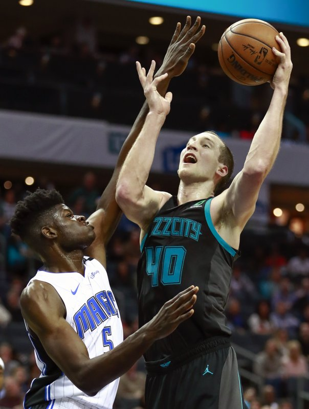Charlotte Hornets center Cody Zeller (40) goes up a basket while being covered by Orlando Magic center Mo Bamba (5) in the first half of an NBA basketball game Monday, Dec. (AP Photo/Jason E. Miczek)