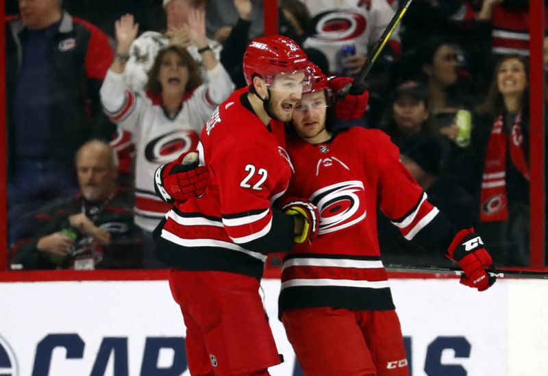 Carolina Hurricanes' Lucas Wallmark, right, is congratulated on his goal by teammate Brett Pesce (22) during the first period of an NHL hockey game against the Philadelphia Flyers, Monday, Dec. (AP Photo/Karl B DeBlaker)