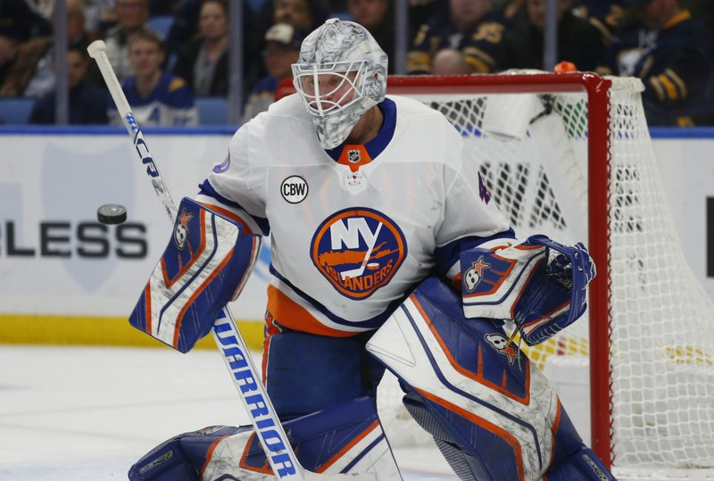 New York Islanders goalie Robin Lehner (40) makes a save during the first period of an NHL hockey game against the Buffalo Sabres, Monday, Dec. (AP Photo/Jeffrey T. Barnes)