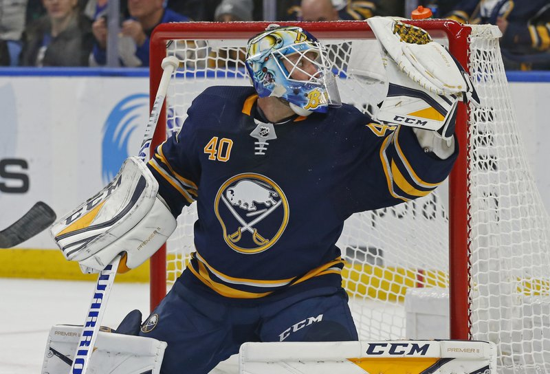 Buffalo Sabres goalie Carter Hutton (40) makes a save during the second period of an NHL hockey game against the New York Islanders, Monday, Dec. (AP Photo/Jeffrey T. Barnes)