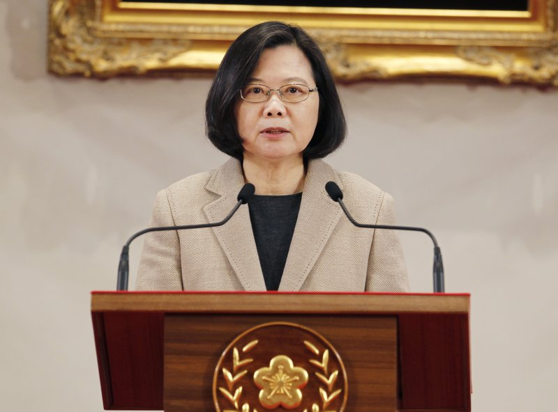 Taiwanese President Tsai Ing-wen delivers a speech during the New Year press conference in Taipei, Taiwan, Tuesday, Jan. (AP Photo/Chiang Ying-ying)