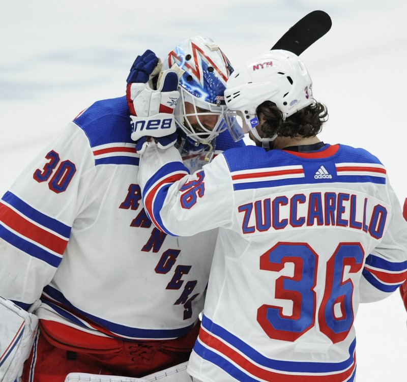 New York Rangers goalie Henrik Lundqvist (30), of Sweden, is congratulated by Mats Zuccarello (36), of Norway, after the team's 2-1 victory over the St. (AP Photo/Bill Boyce)