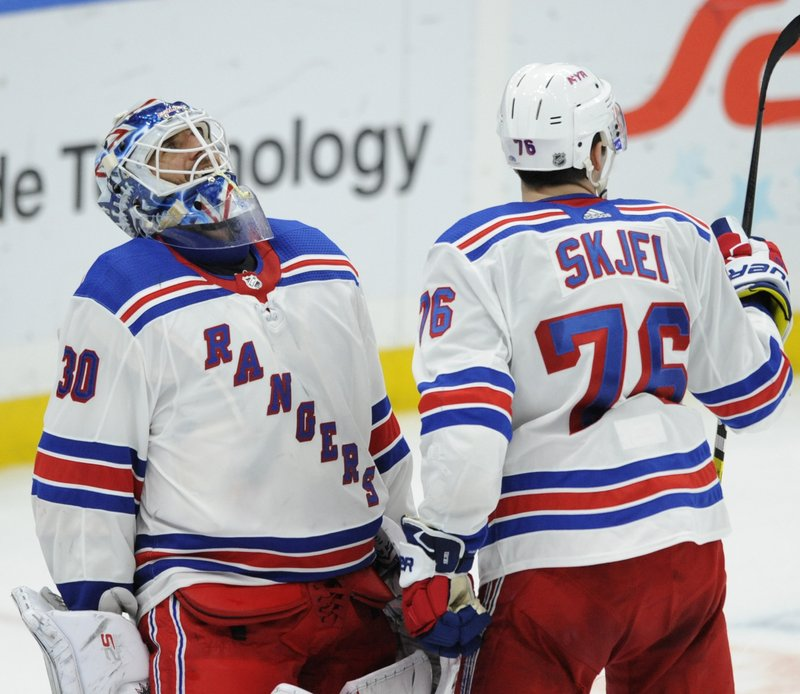 New York Rangers goalie Henrik Lundqvist (30), of Sweden, reacts with Brady Skjei (76) after the team's 2-1 victory over the St. (AP Photo/Bill Boyce)
