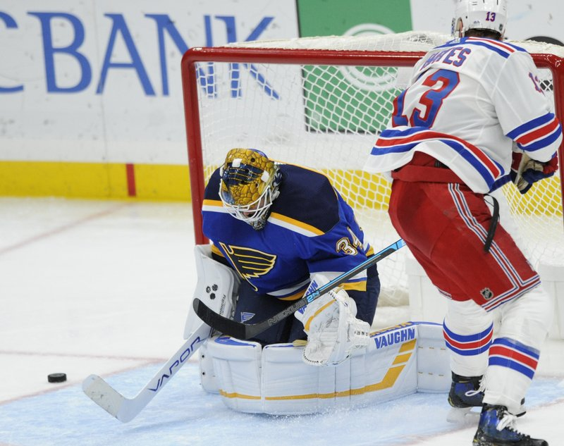 St. Louis Blues goalie Jake Allen (34) blocks a shot by New York Rangers' Kevin Hayes (13) during the third period of an NHL hockey game Monday, Dec. (AP Photo/Bill Boyce)