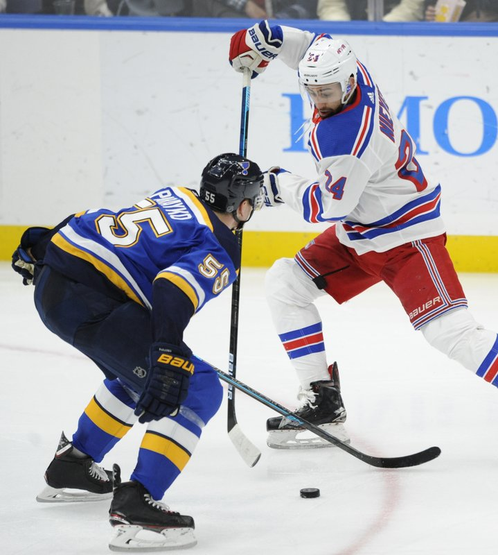 St. Louis Blues' Colton Parayko (55) defends against New York Rangers' Boo Nieves (24) during the second period of an NHL hockey game Monday, Dec. (AP Photo/Bill Boyce)