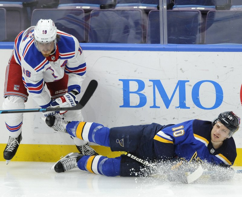 St. Louis Blues' Brayden Schenn (10) is checked by New York Rangers' Marc Staal (18) during the first period of an NHL hockey game Monday, Dec. (AP Photo/Bill Boyce)