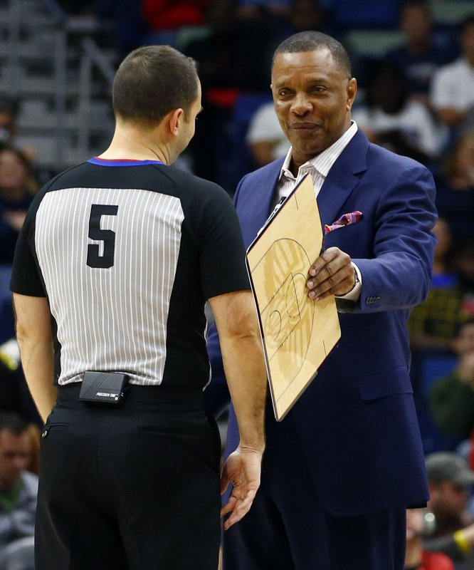 New Orleans Pelicans head coach Alvin Gentry, right, talks with referee Kane Fitzgerald (5) during the first half of an NBA basketball game, Monday, Dec. (AP Photo/Butch Dill)