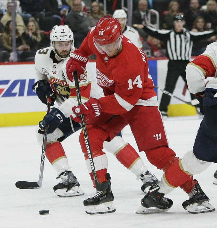 Detroit Red Wings center Gustav Nyquist (14), of Sweden, is pursued by Florida Panthers defenseman Keith Yandle (3) while driving on the goal during the second period of an NHL hockey game Monday, Dec. (AP Photo/Duane Burleson)