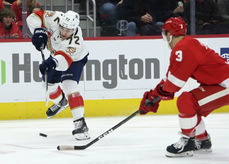 Florida Panthers center Frank Vatrano (72) takes a shot on goal against Detroit Red Wings defenseman Nick Jensen (3) during the first period of an NHL hockey game Monday, Dec. (AP Photo/Duane Burleson)