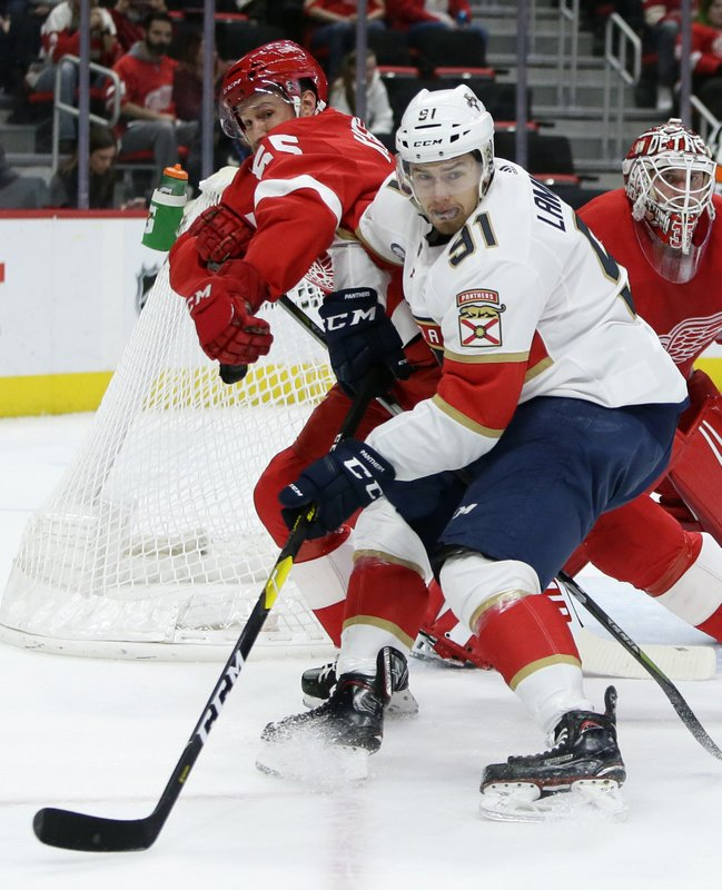 Detroit Red Wings defenseman Niklas Kronwall (55), of Sweden, pushes Florida Panthers right wing Juho Lammikko (91), of Finland, away from the net during the first period of an NHL hockey game Monday, Dec. (AP Photo/Duane Burleson)
