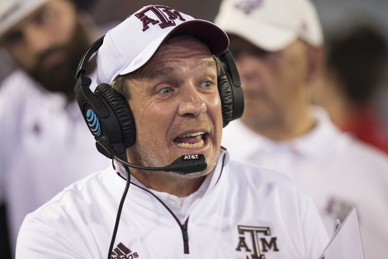 Texas A&M coach Jimbo Fisher watches from the sideline during the first half of the Gator Bowl NCAA college football game against North Carolina State on Monday, Dec. (James Gilbert/The Florida Times-Union via AP)